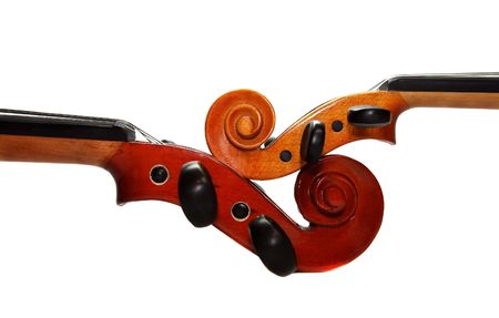 Two violins separately on a white background. A detail Stock Photo - 2445260