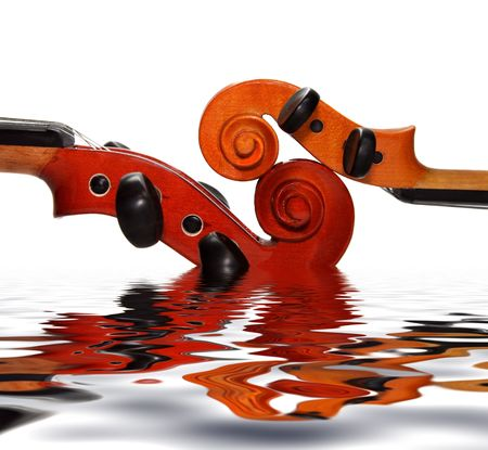Two violins separately on a white background. A detail Stock Photo - 2771604