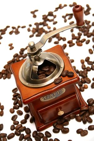 coffe tree: Old-fashioned coffee grinder with coffee beans