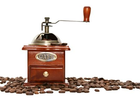 Old-fashioned coffee grinder with coffee beans photo