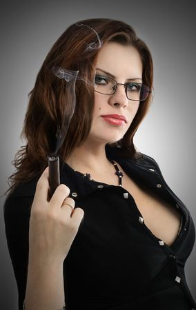 cigar smoking woman: series of images with the beautiful brunette in a black dress Stock Photo