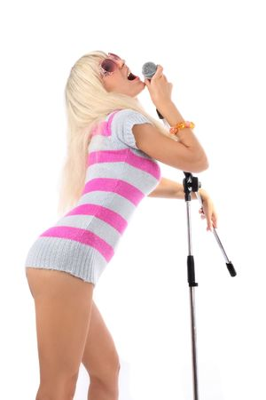 beautiful girl with a microphone on a scene photo