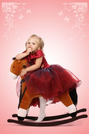Portrait of the beautiful girl on a toy horse Stock Photo - 3566387