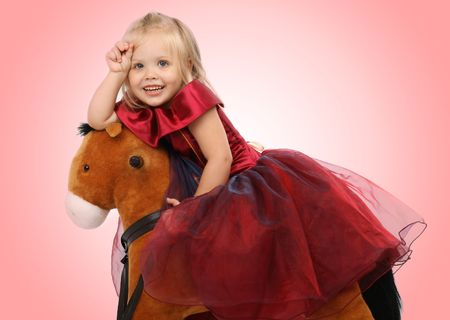 Portrait of the beautiful girl on a toy horse Stock Photo - 3566357