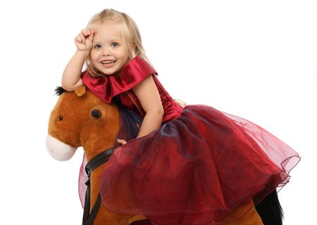 Portrait of the beautiful girl on a toy horse photo