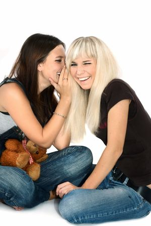brunette and the blonde play with a toy bear photo