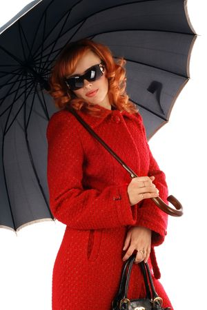 Portrait of the stylish young woman with an umbrella in a red coat Stock Photo - 3828795