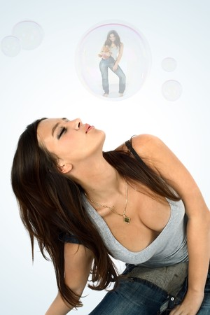 young beautiful brunette and soap bubble photo