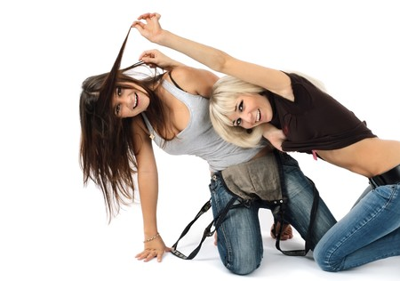Two beautiful girls the blonde and the brunette play childish game
