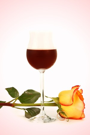 Glass of wine and rose isolated on a pink background Stock Photo - 3947224