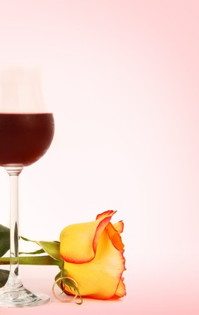 Glass of wine and rose isolated on a pink background Stock Photo - 3947214