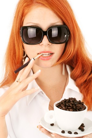portrait young girl studio: young red-haired girl in the dress of the secretary poses with a coffee cup. Pictures well approach for advertising of coffee and cafe