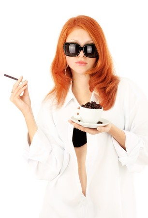 woman tie: young red-haired girl in the dress of the secretary poses with a coffee cup. Pictures well approach for advertising of coffee and cafe