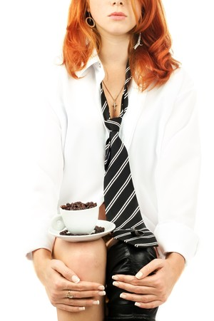 redhead girl: young red-haired girl in the dress of the secretary poses with a coffee cup. Pictures well approach for advertising of coffee and cafe