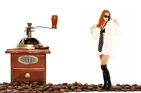 young red-haired girl in the dress of the secretary poses with a coffee grinder. Pictures well approach for advertising of coffee and cafe Stock Photo - 4074699