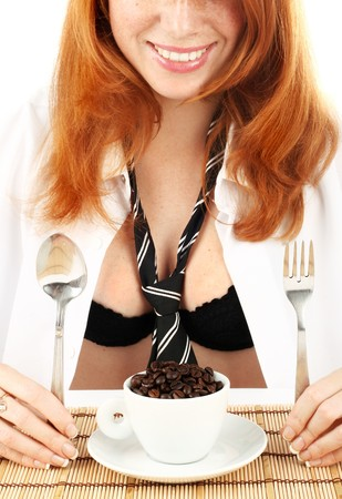 young red-haired girl in the dress of the secretary poses with a coffee grinder. Pictures well approach for advertising of coffee and cafe