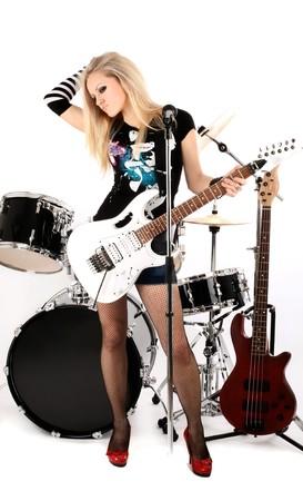 guitarra sexy: serie de fotograf�as en estilo de rock-n-roll con la bella rubia Foto de archivo