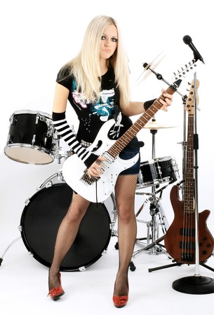 photo series in style rock-n-roll with the beautiful blonde Stock Photo - 4074851