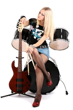 photo series in style rock-n-roll with the beautiful blonde Stock Photo - 4074801