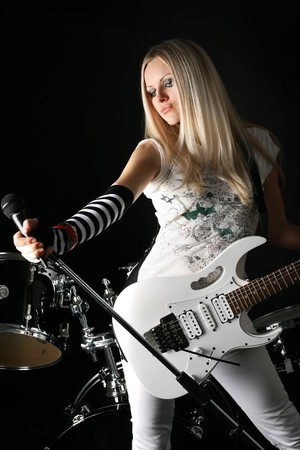photo series in style rock-n-roll with the beautiful blonde Stock Photo - 4074830