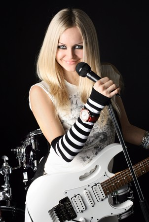 photo series in style rock-n-roll with the beautiful blonde Stock Photo - 4074872