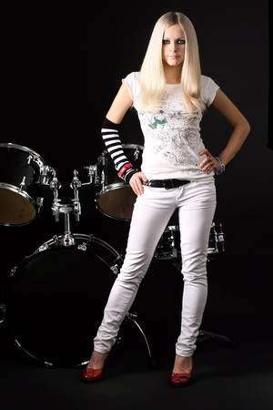 photo series in style rock-n-roll with the beautiful blonde Stock Photo - 4074783