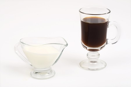 demitasse: Cup of coffee and milk on a white background