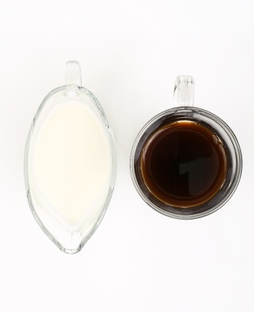 stuffing: Cup of coffee and milk on a white background