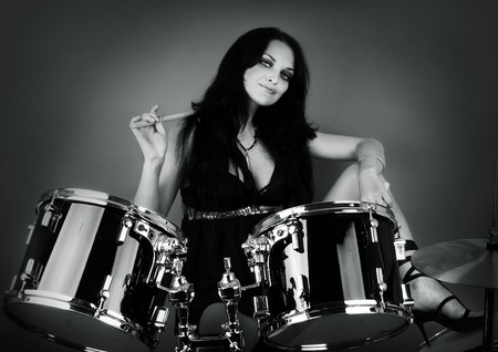 drum and bass: series of photos of the magnificent brunette in style sexy rock-n-roll Stock Photo