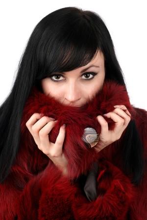 portrait of brunette is in a red fur coat photo
