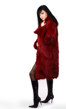 portrait of brunette is in a red fur coat photo