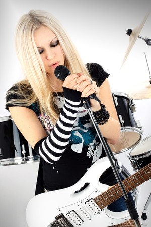 photo series in style rock-n-roll with the beautiful blonde Stock Photo - 4481961