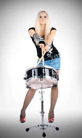 photo series in style rock-n-roll with the beautiful blonde Stock Photo - 4481579