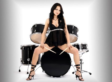 bass drum: series of photos of the magnificent brunette in style sexy rock-n-roll Stock Photo