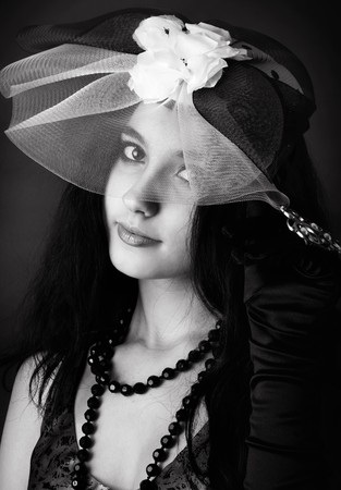 Series. Portrait of the beautiful brunette in a dark blue dress photo