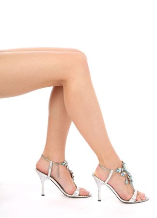 Beautiful female legs on a white background photo
