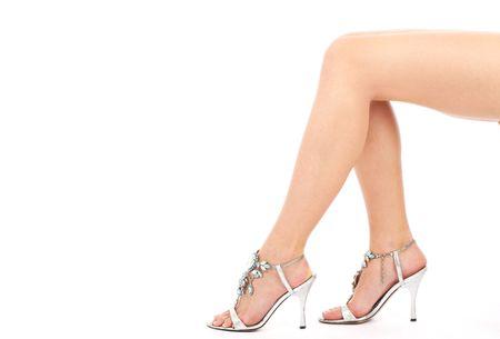 Beautiful female legs on a white background photo