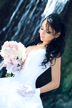 bridal veil: Portrait of the young beautiful bride