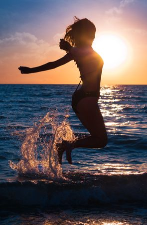 Series. The young beautiful girl walks on a beach photo