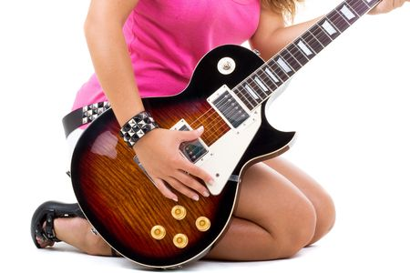 bass guitar women: Series. Beautiful brunette with a curly hair poses in studio with a guitar Stock Photo