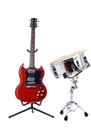 Electric guitar and snare drum isolated on white background photo