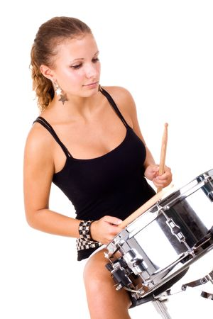 Series. The beautiful brunette and snare drum it is isolated on a white background photo