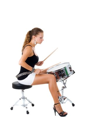 snare: Series. The beautiful brunette and snare drum it is isolated on a white background