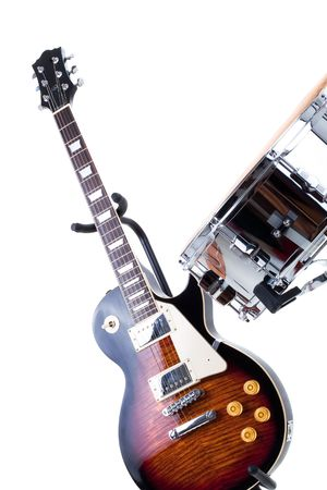 Series. Electric guitar and snare drum isolated on white background photo