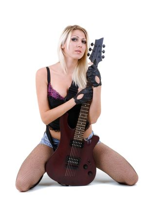 Series. The beautiful blonde with a guitar Stock Photo - 5945759
