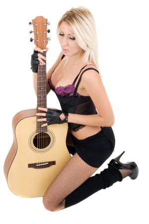 Series. The beautiful blonde with a guitar Stock Photo - 5945758