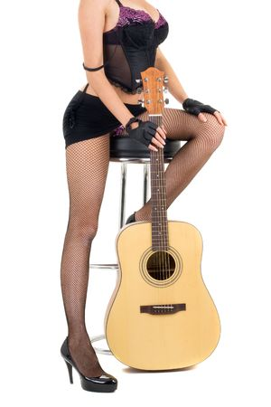 Series. female legs and guitar isolated on a white background Stock Photo - 5945756