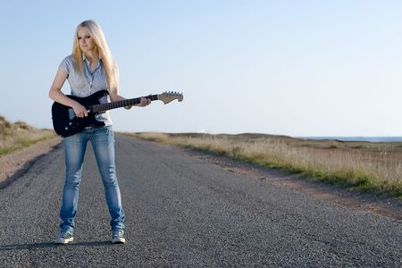 jeans girl: Series. The beautiful blonde with a guitar