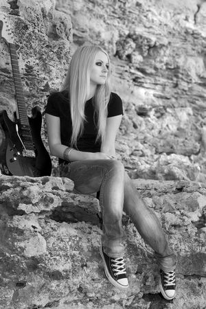 girl playing guitar: Series. The beautiful blonde with a guitar