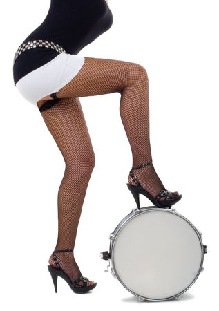 snare drum: Series.Legs of beautiful brunette and snare drum it is isolated on a white background